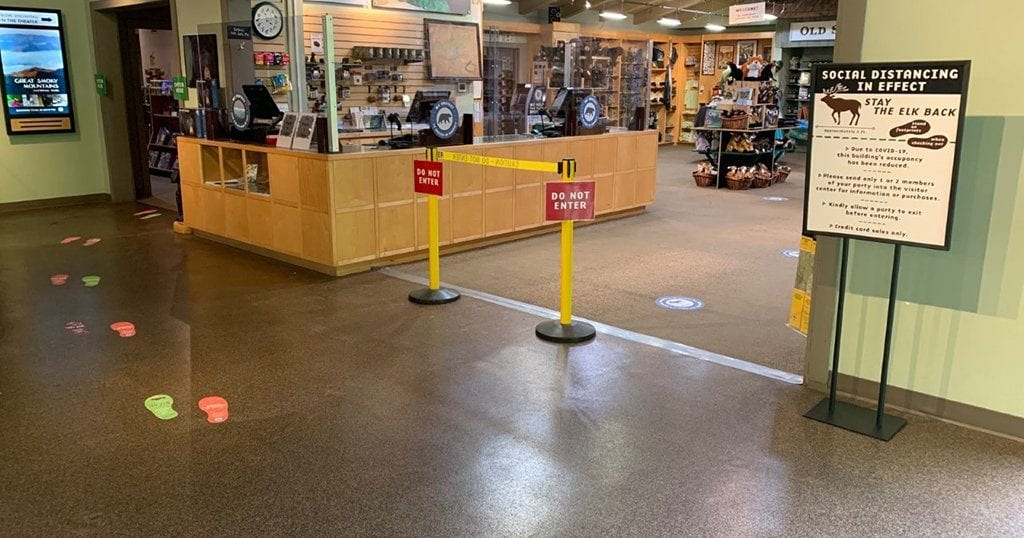 Floor stickers, signs and barriers have been installed inside the park's visitor centers to encourage healthy practices and social distancing. (photo courtesy of GSMNP)