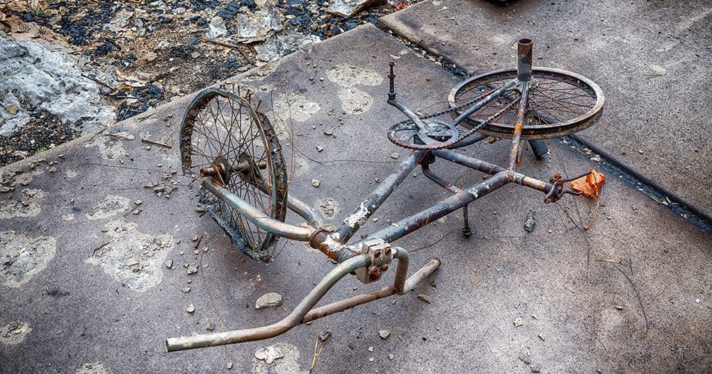 Child's bicycle destroyed by the Gatlinburg fire (Carolyn Franks / Shutterstock.com)