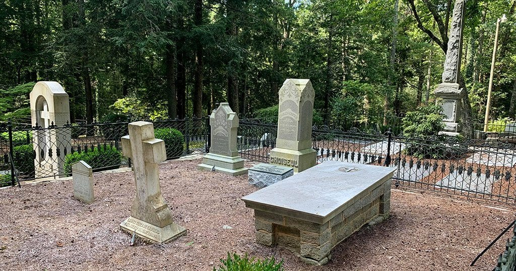 Elaborate southern graves with ornate markers and giant stone slabs, represent the wealthy people who at one time worshipped at St. Johns (photo by John Gullion/TheSmokies.com)