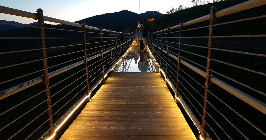 The SkyBridge at Gatlinburg's SkyLift Park lights up at night to create a beautiful ambiance (photo by Greg and Laura Akens)