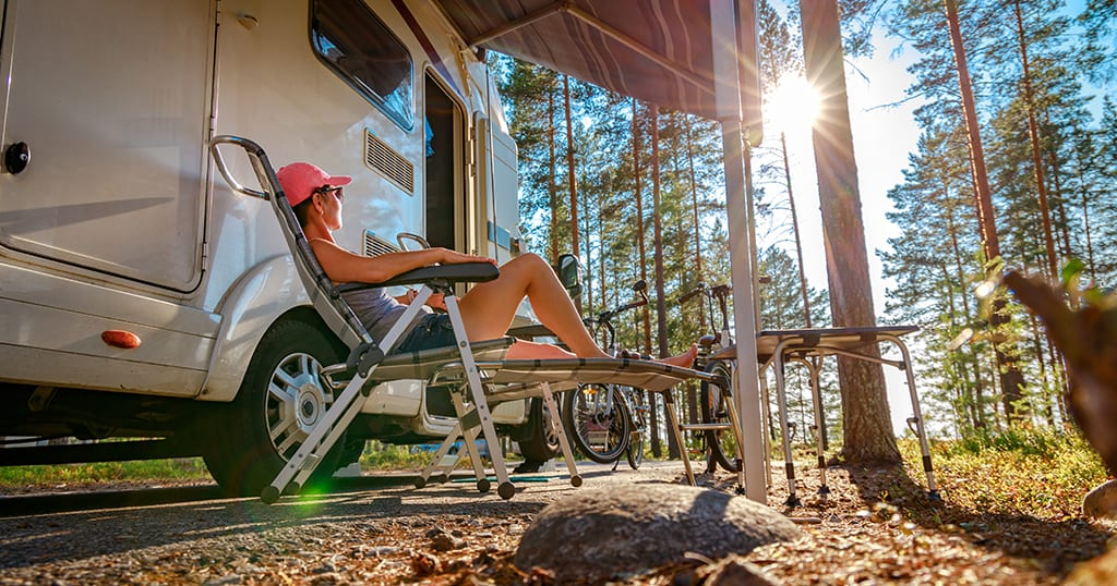 Woman relaxing at camper