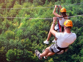 Couple ziplining